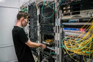 technician-rewiring-cables.jpg