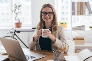 smiling woman on computer
